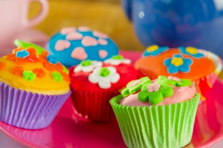 Colorful cupcakes by the tea photo