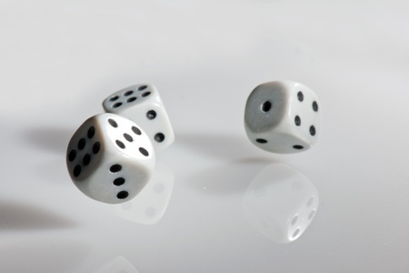 Throwing black and whitel dices for paying a game