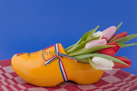 Wooden clog with tulips from Holland photo