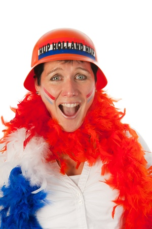 Dutch woman dressed in orange and yelling as a soccer fan photo