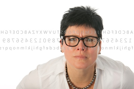 Woman with glasses can't read very well Stock Photo - 12338525