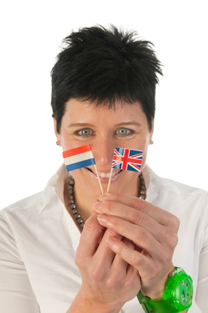 neckless: Happy smiling young woman with English and Dutch little flag  as studio portrait