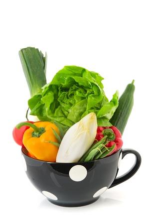 Big black bowl full of assortment fresh vegetables photo