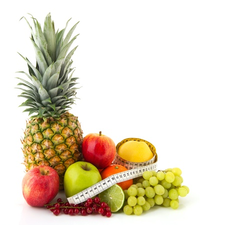Fruit still life with ananas apples oranges and measurement tape Stock Photo