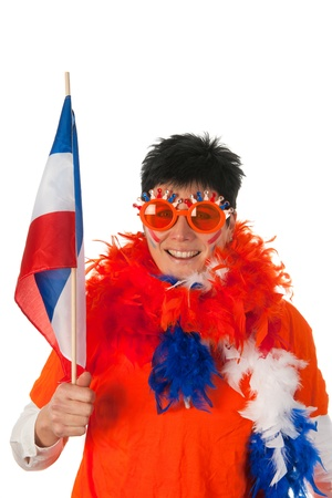 Dutch woman dressed in orange with Holland flag as a soccer fan photo