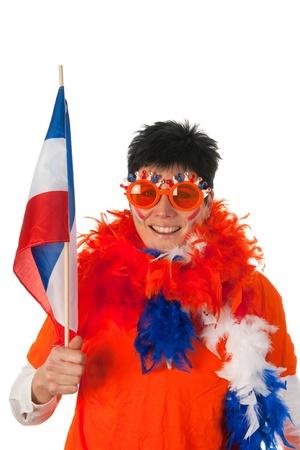 drapeau hollande: Femme hollandaise habill�s en orange avec le drapeau Hollande en tant que fan de football Banque d'images