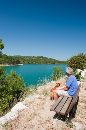Man sitting at lake de Sainte Croix in the French Provence Stock Photo - 12338743