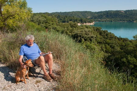 Man sitting at lake de Sainte Croix in the French Provence photo