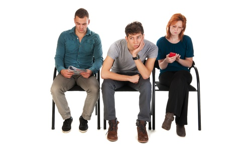 people sitting: Young people are waiting in a room  Stock Photo