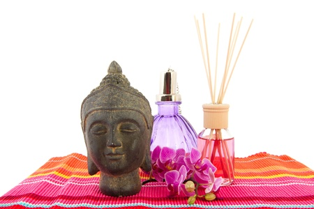 Tropical pink orchid with Buddha and scented sticks photo