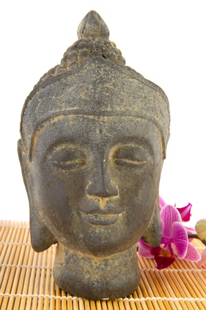 Buddha statue with pink Orchid and bamboo photo