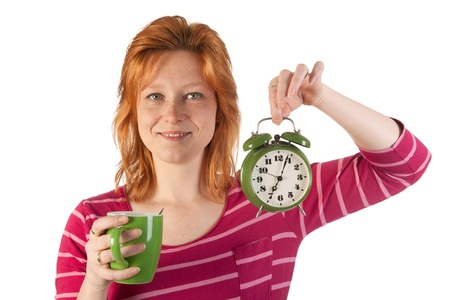 Young woman is enjoying het morning coffee while wake up very early Stock Photo - 12340167