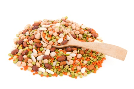 legumes: Mixed legumes with wooden spoon isolated over white background