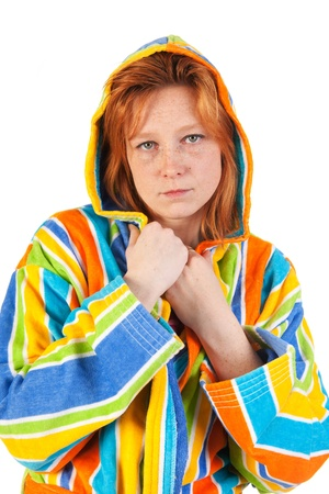 Young woman in colorful bathrobe with hood photo