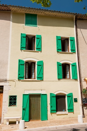 Typical French house in the Provence with green shutters photo