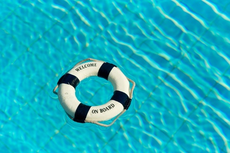 Welcome on board with life buoy in swimming pool photo