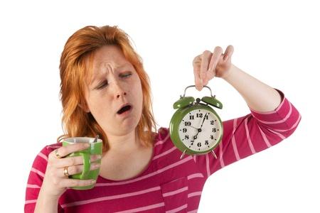 striped pajamas: La mujer joven est� disfrutando de caf� de la ma�ana, mientras que het despertar muy temprano