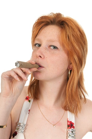 cigar smoking woman: Portrait of an young woman smoking a cigar