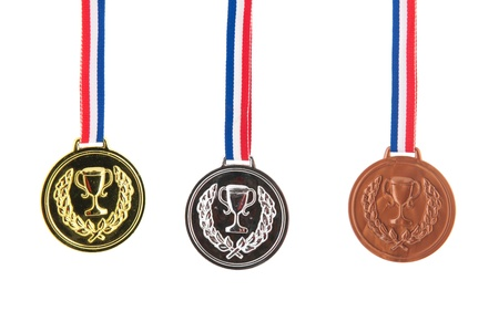 Three medals for the winners isolated over white background photo
