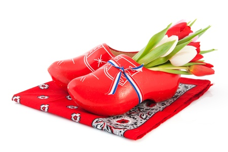 Red Dutch wooden clogs with colorful tulips on handkerchief photo