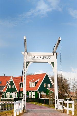 marken: Typical Dutch village Marken with wooden green houses and small bridge Editorial