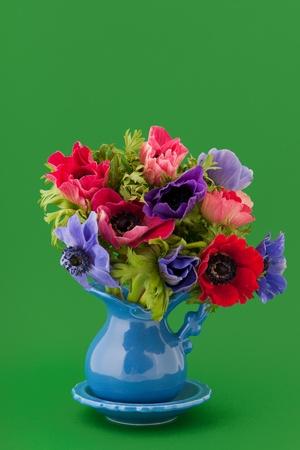 mixed flower bouquet: Little vase with colorful bouquet Anemones