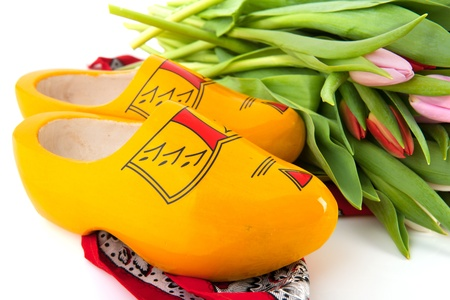 Yellow Dutch wooden clogs with colorful tulips photo