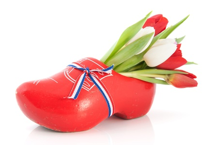 Red Dutch wooden clogs with colorful tulips photo