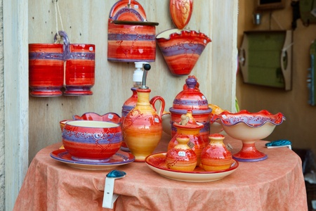 shop with colorful handmade pottery outdoor photo
