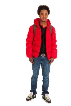 Black schoolboy in red coat wit backpack photo