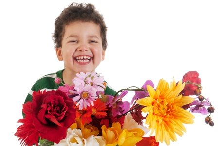Happy smiling boy with colorful bouquet flowers photo