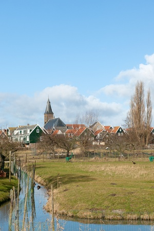 marken: Typical Dutch village Marken with wooden green houses and small ditches Stock Photo