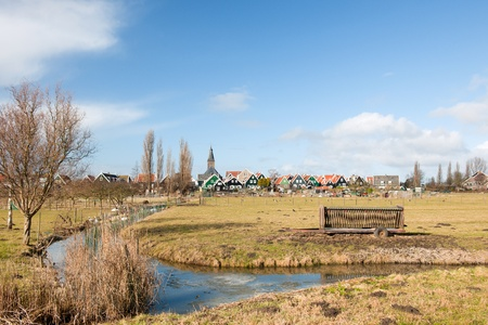 Typical Dutch village Marken with wooden green houses and small ditches Stock Photo - 12721390