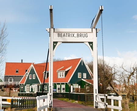 beatrix: Typical Dutch village Marken with wooden green houses and small bridge Stock Photo
