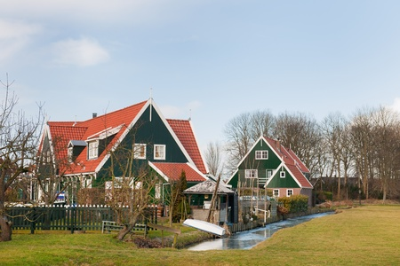 Typical Dutch village Marken with wooden green houses and small ditches