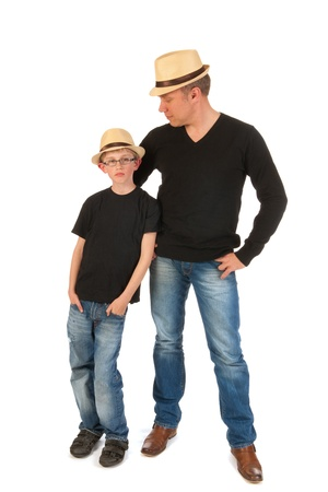 Father and son posing with straw hats in studio photo