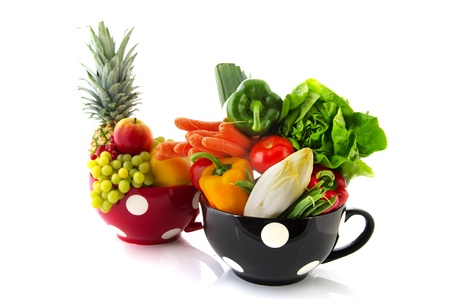 Black and red cup full with fruit and vegetables photo