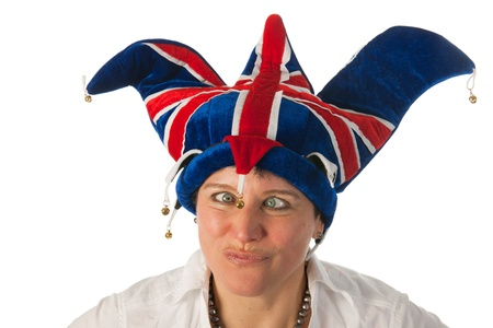 Woman is wearing a funny Brittish hat and looks cross eyed to bell photo