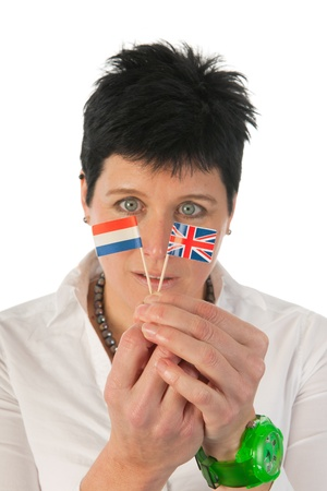 Young woman with English and Dutch little flag  with focus on flags Stock Photo - 12721589
