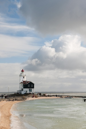 marken: White lighthouse at the Dutch coast in Marken