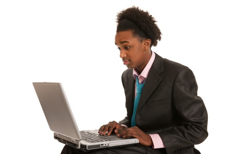 Young black business man surprised by the laptop photo