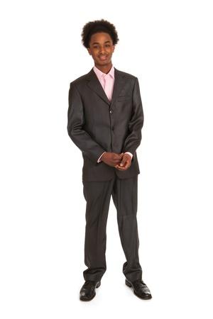 Junge schwarze Geschäftsmann stand im Studio Lizenzfreie Bilder
