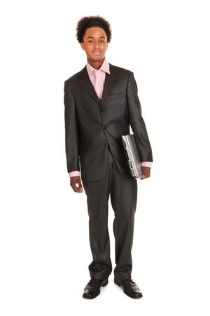 black business man: Homme d'affaires noir avec un ordinateur portable isol� sur fond blanc Banque d'images