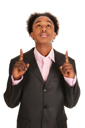 Black business man pointing up isolated over white background photo