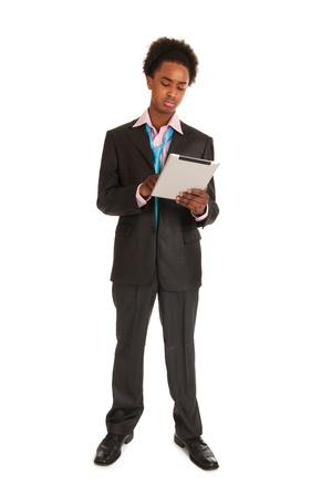 black business man: Jeune homme d'affaires noir avec tablette PC en studio