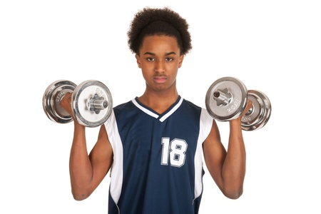 Young black boy is doing workout with dumbbells photo