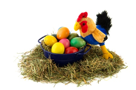 Blue bucket with straw and colorful painted easter eggs with chicken photo