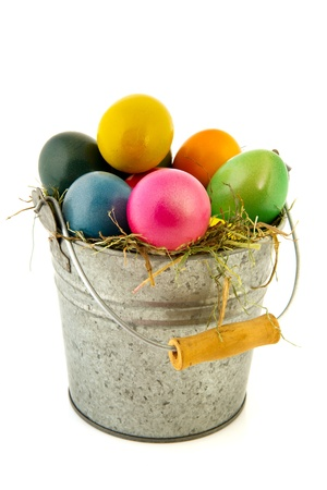 Sinc bucket with straw and colorful painted easter eggs photo