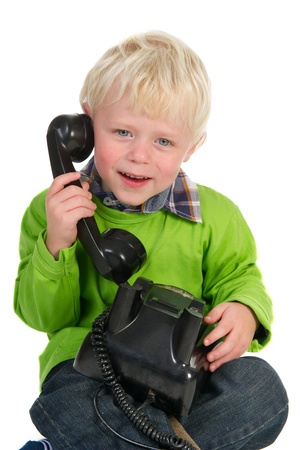 Little blond toddler calling on the antique phone Stock Photo - 13057659