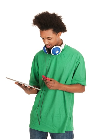 Black boy is having tablet and smartphone Stock Photo - 13057808